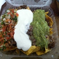 Photo taken at Garcia's Taqueria by Andrew P. on 3/6/2014