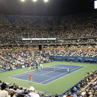 Photo taken at Arthur Ashe Stadium - USTA Billie Jean King National Tennis Center by Eric T. on 9/5/2013