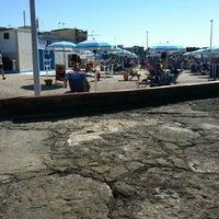 Photo taken at Spiaggia Aeronautica Militare - Santo Spirito by Simone C. on 6/16/2013