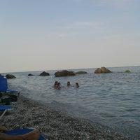 Photo taken at Velika Beach by Dimos A. on 8/25/2013