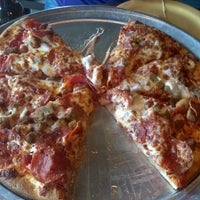 Photo taken at Extreme Pizza by Jon C. on 7/25/2013