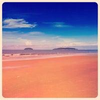 Photo taken at Tanjung Aru Beach by Farah N. on 1/18/2013