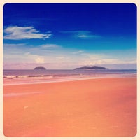 Photo taken at Tanjung Aru 1st Beach by Farah N. on 1/18/2013