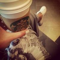 Photo taken at Starbucks by Mel B. on 7/4/2014