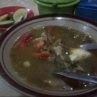 Photo taken at Soto Madura Bapak H. Ngatidjo Roxy by andy k. on 6/12/2013