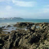 Photo taken at Escalera 18 de la playa de San Lorenzo by Rodrigo V. on 3/3/2013