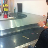 Photo taken at Arrival Hall (Terminal 2) by Andy W. on 12/3/2012