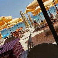 Photo taken at Kumsal Beach by Melisa Ç. on 8/4/2015