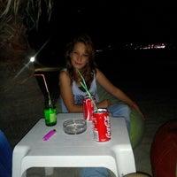 Photo taken at Kılıç Beach Club by Melis A. on 7/6/2015