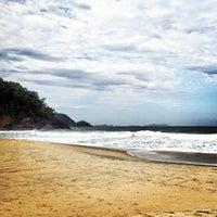 Photo taken at Praia do Félix by Thiago P. on 7/21/2013