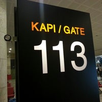 Photo taken at Gate 113 by Uğur K. on 10/3/2012
