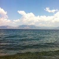 Photo taken at Vlastos beach by Stelios K. on 6/15/2013