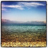 Photo taken at Vlastos beach by Stelios K. on 5/3/2013