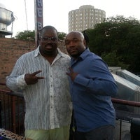 Photo taken at Reggie's Trainwreck Rooftop Deck by Jonathan W. on 7/25/2013