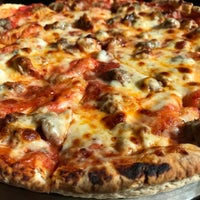 Photo taken at Mannie & Bo's Pizzeria by Aaron U. on 10/28/2017