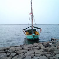 Photo taken at Ancol Beach by Kang I. on 8/8/2015