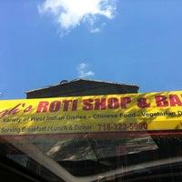 Photo taken at Singh's Roti Shop by Randall R. on 8/4/2011