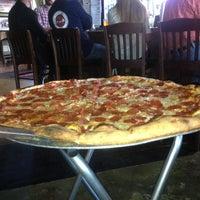 Photo taken at Momo's Pizza by Jennifer G. on 4/25/2013
