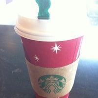Photo taken at Starbucks by Farah G. on 12/20/2012