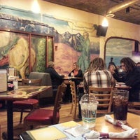 Photo taken at One World Eats & Drinks by Rebecca K. on 12/12/2012