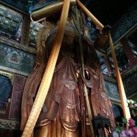 Photo taken at Yonghegong Lama Temple by Elena E. on 4/10/2013