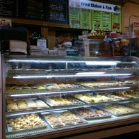 Photo taken at Rainbow Donuts by uTINGme on 8/17/2013