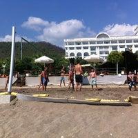 Photo taken at Amara Dolce Vita Beach by Gül M. on 9/17/2012