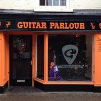Photo taken at guitar parlour by Al K. on 12/27/2014