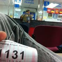 Photo taken at Pejabat Pos (Post Office) by Hairi C. on 12/20/2012