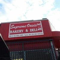 Photo taken at Supreme Oasis Bakery & Deli by Michael-Alan G. on 9/22/2013