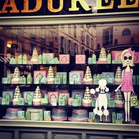 Photo taken at Ladurée Paris Bonaparte by Yuliana on 7/27/2013