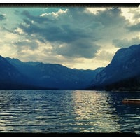 Photo taken at Bohinjsko jezero (Bohinj Lake) by Damjan P. on 7/20/2013