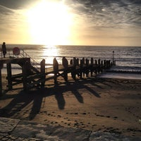 Photo taken at Aberystwyth Beach by Max R. on 4/17/2013