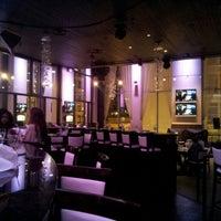 Photo taken at PNK Restaurant & Ultra Lounge by Jasmine W. on 1/10/2013
