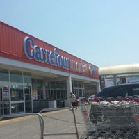 Photo taken at Carrefour Market by george m. on 8/7/2013