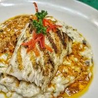 Photo taken at Runas Peruvian Cuisine by Runas P. on 4/19/2017