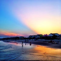 Photo taken at Isle of Palms Beach by Mark S. on 9/1/2013