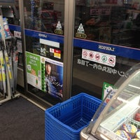Photo taken at LAWSON by Shuji O. on 1/12/2013