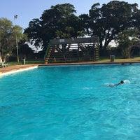 Photo taken at Tesoriere Swimming Pool by Chris F. on 4/2/2014