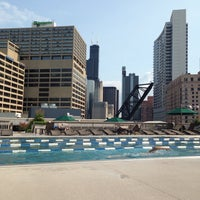Photo taken at East Bank Club Pool Deck by Heather W. on 7/17/2014