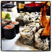 Photo taken at Murasaki Restaurant and Sushi Bar by Christina N. on 6/14/2013