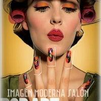 Photo taken at Imagen Moderna + Diseños Salón by Karen M. on 9/11/2014