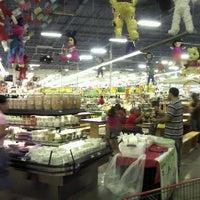 Photo taken at Mi Tienda by Marlon C. on 12/2/2012