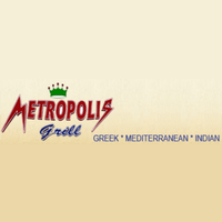 Photo taken at Metropolis Grill by Metropolis Grill on 6/18/2015