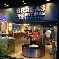 Photo taken at Brasas Argentinas by Mario P. on 1/4/2013