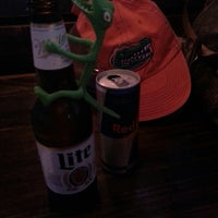 Photo taken at Charlie's Neighborhood Bar & Grill by Kat L. on 11/29/2014