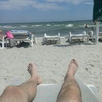 Photo taken at Cetate Beach by Liviu V. on 6/30/2015