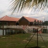 Photo taken at Pantai Sri Tujoh by NA J. on 5/30/2013