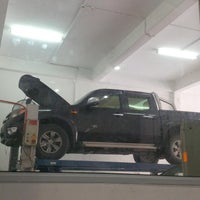 Photo taken at Ford Sales & Service Center by Syawaludin Y. on 12/8/2014