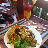 Photo taken at Flame tree restaurant by Lucy M. on 12/25/2012